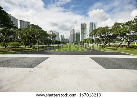 Manila American Cemetery and Memorial with cityscape; Manila; Philippines - stock photo