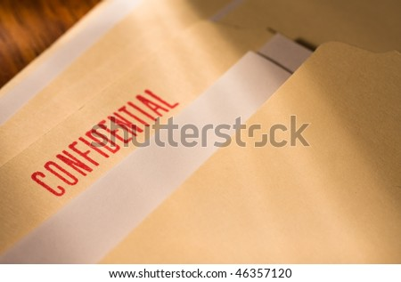 "Manila folder labeled ""confidential"" stamp in red. - stock photo"