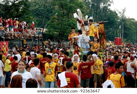 MANILA - JAN. 9: Devotees celebrate the feast of The Black Nazarene on January 9, 2012 in Manila Philippines. The fiesta celebrated by hundred thousands devotee parading the image in the city. - stock photo