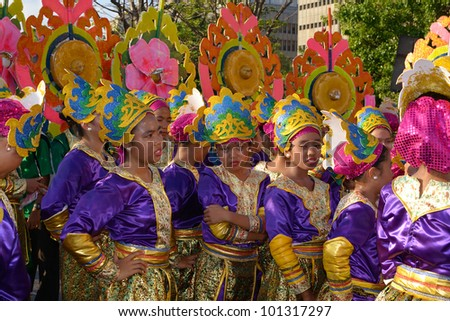 MANILA, PHILIPPINES - APR. 14: Street dancers break-time during Aliwan Fiesta, which is the biggest annual national festival competition on April 14, 2012 in Manila Philippines. - stock photo