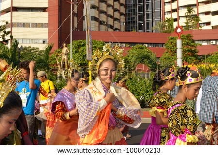 MANILA, PHILIPPINES - APR. 14: street dancers enjoying break-time during Aliwan Fiesta, which is the biggest annual national festival competition on April 14, 2012 in Manila Philippines. - stock photo