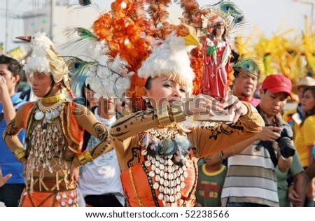 MANILA, PHILIPPINES – APRIL 24: Street dancer showcase Filipino culture & tradition in The Aliwan Fiesta on April 24, 2010 in Manila. The Aliwan celebrated with annual street dance competition - stock photo