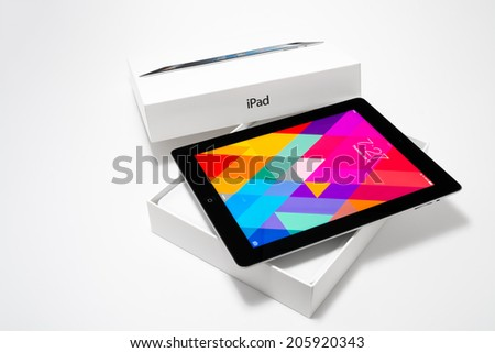 Manila,Philippines - July 17, 2014: Unpacking an Apple Ipad 4th generation (Retina Display) with iOS 7. iOS 7 new operation system from Apple Inc. It was released on September 18, 2013. - stock photo