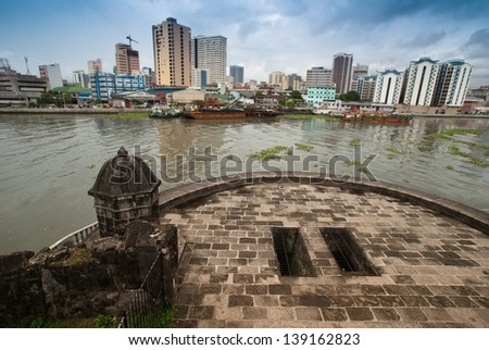 Manila's cityscape view from Media Naranja the large semicircular gun platform in Fort Santiago,  Intramuros district of Manila , Philippines. - stock photo