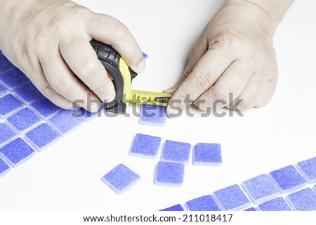 Manipulating tiles for pools, worker workman - stock photo