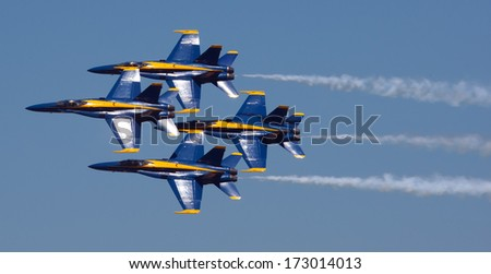 MANKATO, MN- JUNE 9 US Navy Blue Angels in F-18. Hornet planes perform in air show routine in Mankato, MN on June 9th 2012. Blue Angels are the oldest active aerobatic team in the world - stock photo