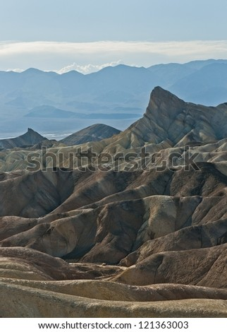 Manly beacon and the Golden canyon in Death valley shot from Zabriskie point - stock photo