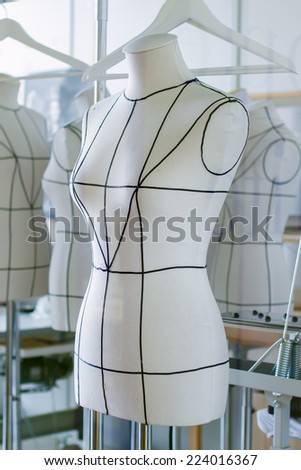 Mannequin dummy in a tailor shop - stock photo
