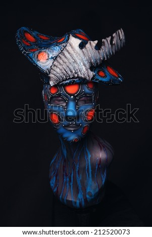 Mannequin girl in airbrush mask and headwear - stock photo