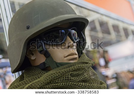 Mannequin in an army helmet and tactical goggles - stock photo