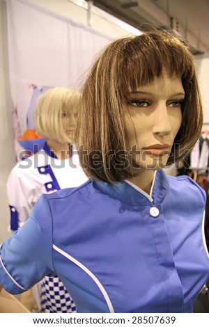 Mannequin in suit of charwoman.