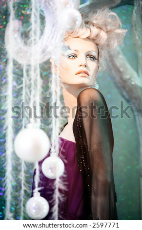 Mannequin in the window set up with a winter theme. - stock photo