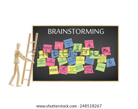 Mannequin leaning ladder on blackboard with Brainstorming post it notes (research, creativity, innovation, list roadblocks, vision, no criticism, listen) isolated on white background - stock photo