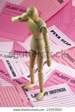 Mannequin surrounded by pink slips in dejected pose - stock photo