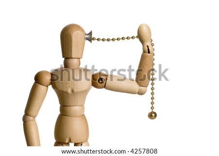 Mannequin with a pull chain switch attached to the side of his head.  The mannequin is pulling the chain to self activate.  Conceptual image for the big idea, motivation, empowerment, etc. - stock photo