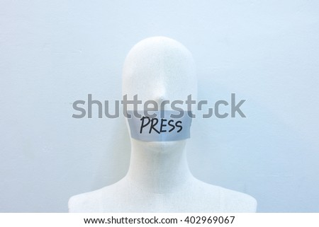mannequins gagged with tape to write the press, World Press Freedom Day - stock photo