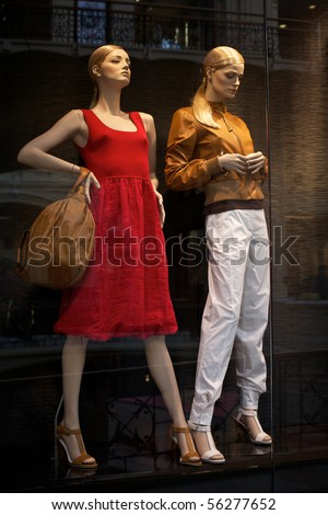 Mannequins in clothes shop. No brandnames or copyright objects - stock photo