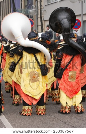 Mannheim, Germany - February 15, 2015: Fastnachtsumzug - carnival parade - traditional public event in the streets of Mannheim drew a crowd of 300.000 viewers. Two tuba players - stock photo
