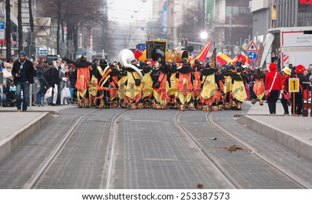 Mannheim, Germany - February 15, 2015: Fastnachtsumzug - carnival parade - traditional public event in the streets of Mannheim drew a crowd of 300.000 viewers. View of parade from behind. - stock photo