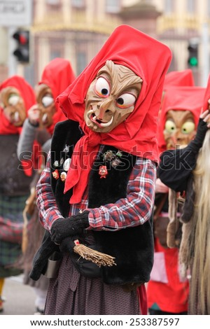 Mannheim, Germany - February 15, 2015: Fastnachtsumzug - carnival parade - traditional public event in the streets of Mannheim drew a crowd of 300.000 viewers. Traditional wooden masks. - stock photo
