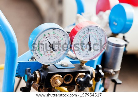 manometer gages on equipment for filling automotive air conditioners - stock photo