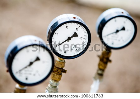 manometers on the pipes - stock photo