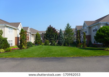 Manor and village buildings for retirement seniors - stock photo