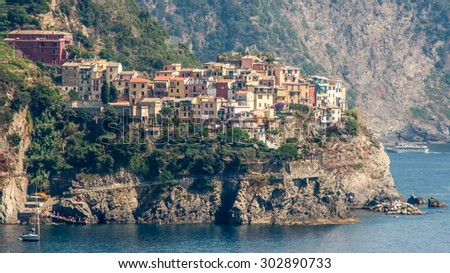 Manorola town in Cinque Terre in Liguria along the north western Italian Coast in sunny summer day - UNESCO world heritage site - architecture background  - stock photo