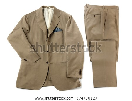Mans beige suit with neatly folded pants and jacket with a handkerchief in the pocket isolated on white - stock photo