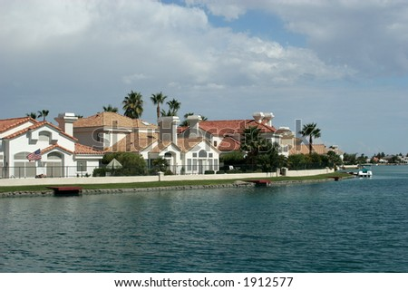 Mansions by the lake - stock photo