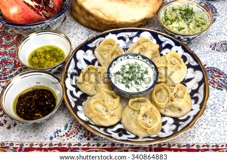 manti - dumplings of minced lamb wrapped in unleavened dough and cooked by steaming - stock photo