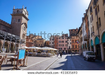 MANTOVA, ITALY - APRIL 18, 2016: The Palazzo Ducale building on a square with restaurants in the city center - stock photo