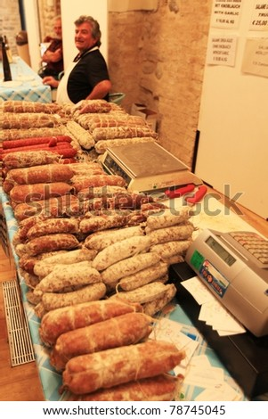 MANTOVA, ITALY - JUNE 14: Local salami in exhibition at Golosaria, national fair of food and gastronomy culture June 14, 2010 in Mantova, Italy. - stock photo
