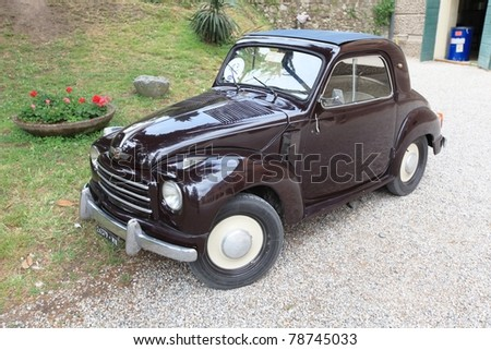 MANTOVA, ITALY - JUNE 14: Old car Fiat Topolino in exhibition at Golosaria, national fair of food and gastronomy culture June 14, 2010 in Mantova, Italy. - stock photo