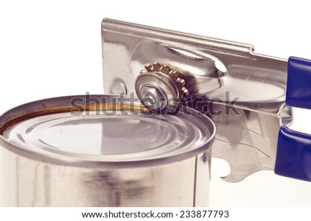 Manual Can Opener With Tin Can On White Background - stock photo