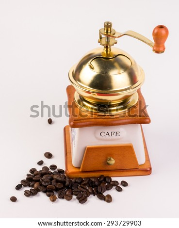 Manual coffee grinder and cofee bean isolated - stock photo