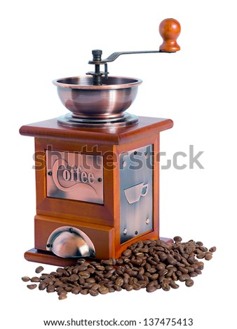 manual coffee grinder with coffee beans isolated on white background - stock photo