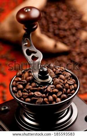 Manual coffee grinder with coffee beans - top view - stock photo