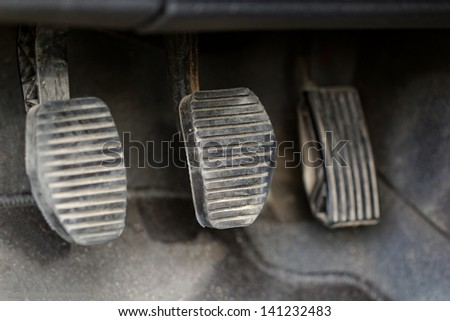 manual gear shifter car pedals - stock photo