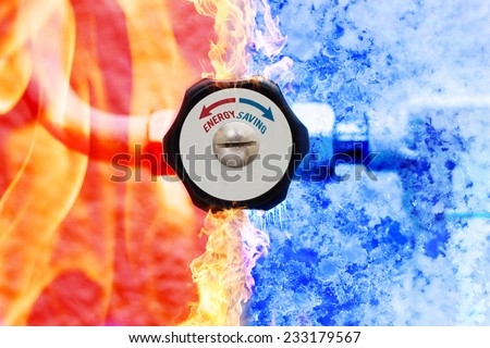 manual heating controller with red and blue arrows in fire and ice background - stock photo