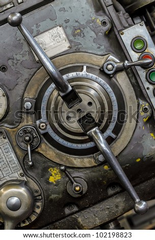 Manual levers and control buttons of old industrial milling machine - stock photo