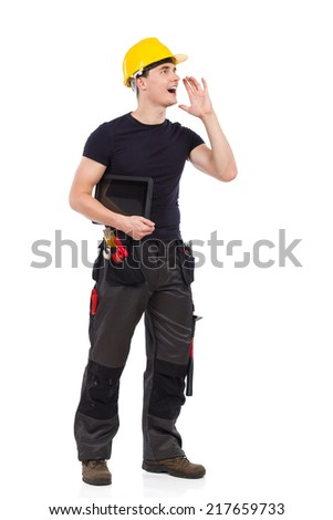 Manual worker holding digital tablet under the arm and shouting. Full length studio shot isolated on white. - stock photo
