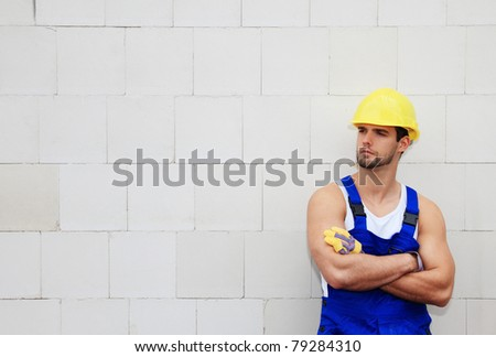 Manual worker on construction site. - stock photo