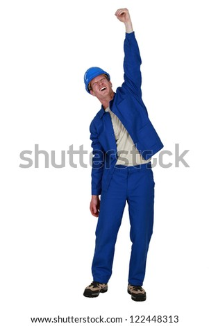 Manual worker raised clenched fist in the air - stock photo