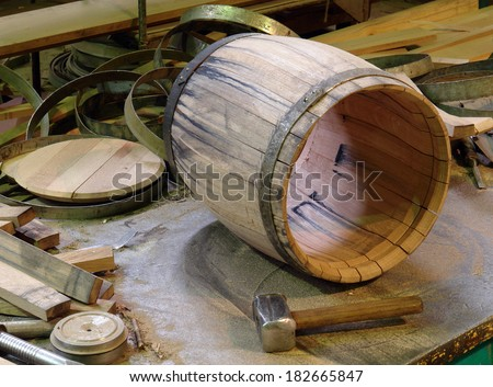 manufacture of wooden barrels in the factory, - stock photo