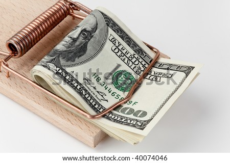 Many American dollar bills in mousetrap - stock photo