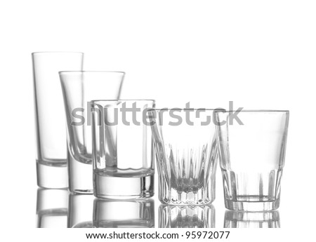 Many an empty wineglass isolated on white - stock photo