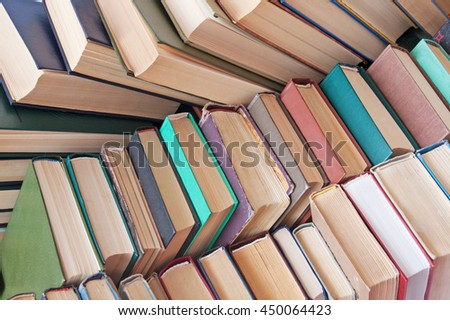 Many antique books in a book library. Book shop concept - stock photo