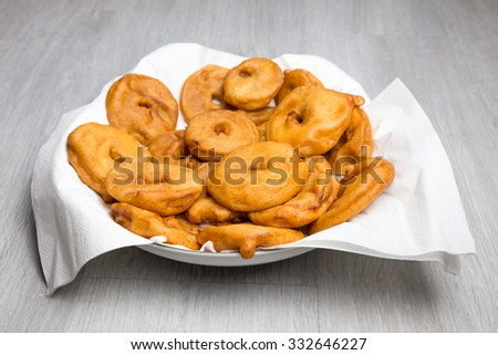 Many apple fritters with white napkins on scale - stock photo