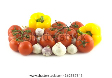 Many assorted ripe vegetables isolated on white close up - stock photo